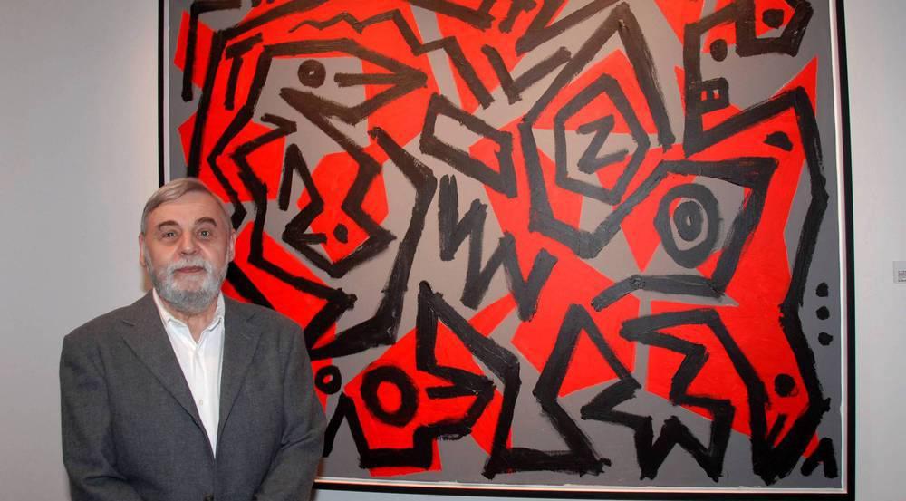 A. R. Penck vor einem seiner Gemälde im Jahr 2006 in München