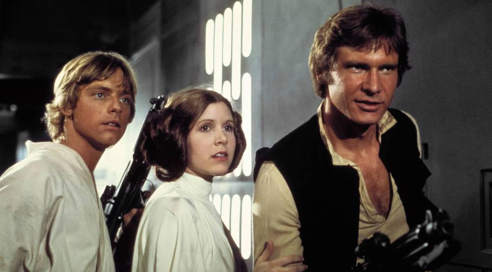 Harrison Ford (r.) als Han Solo, Carrie Fisher als Prinzessin Leia und Mark Hamill als Luke Skywalker sind aus dem