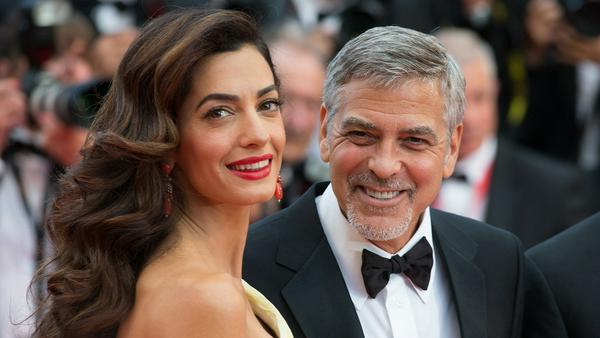 George und Amal Clooney setzen sich für Flüchtlinge ein