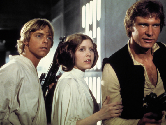 Prinzessin Leia (Carrie Fisher) zwischen Luke Skywalker (Mark Hamill) und Han Solo (Harrison Ford)