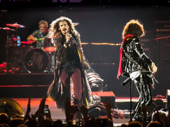 Steven Tyler (M.) und Aerosmith bei einem Auftritt im Jahr 2014