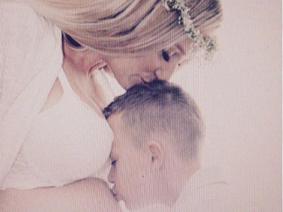 Lukas Podolskis Frau Monika und ihr Sohn Louis