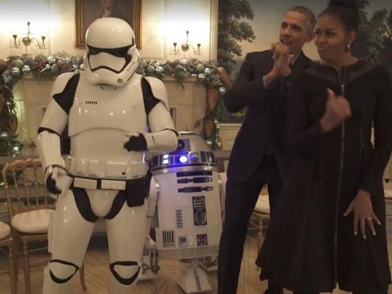 Barack Obama und seine Frau Michelle tanzen mit Storm Troopers und R2D2