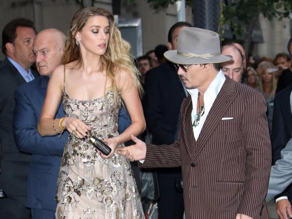 Amber Heard und Johnny Depp - hier im Sommer 2015 - haben sich im Scheidungskrieg doch noch die Hände gereicht